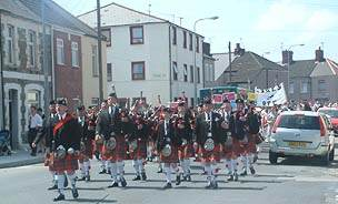 The Welsh Pipe Band lead the parade down Cornwall Street